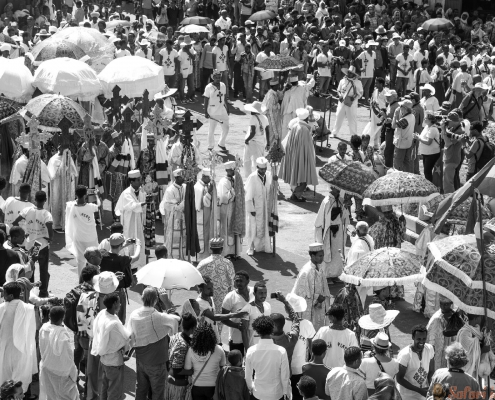 A crowd of faithful and tourists surrounding a procession in the annual religious celebration of Timket (epiphany) B&W