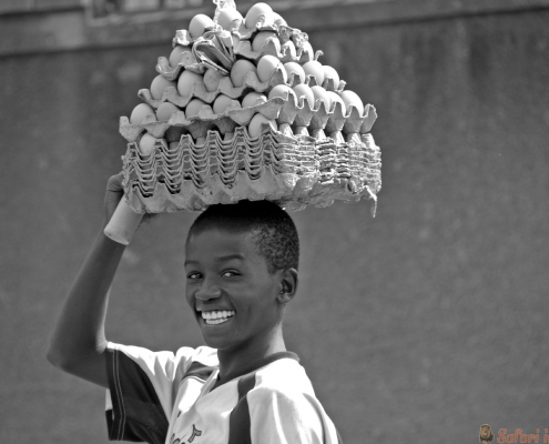 Beautiful smile of boy selling eggs Kampala, Uganda B&W