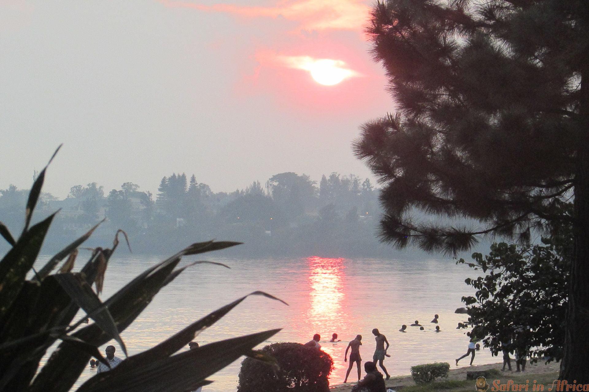 Boys enjoying water at the sunset Gisenyi