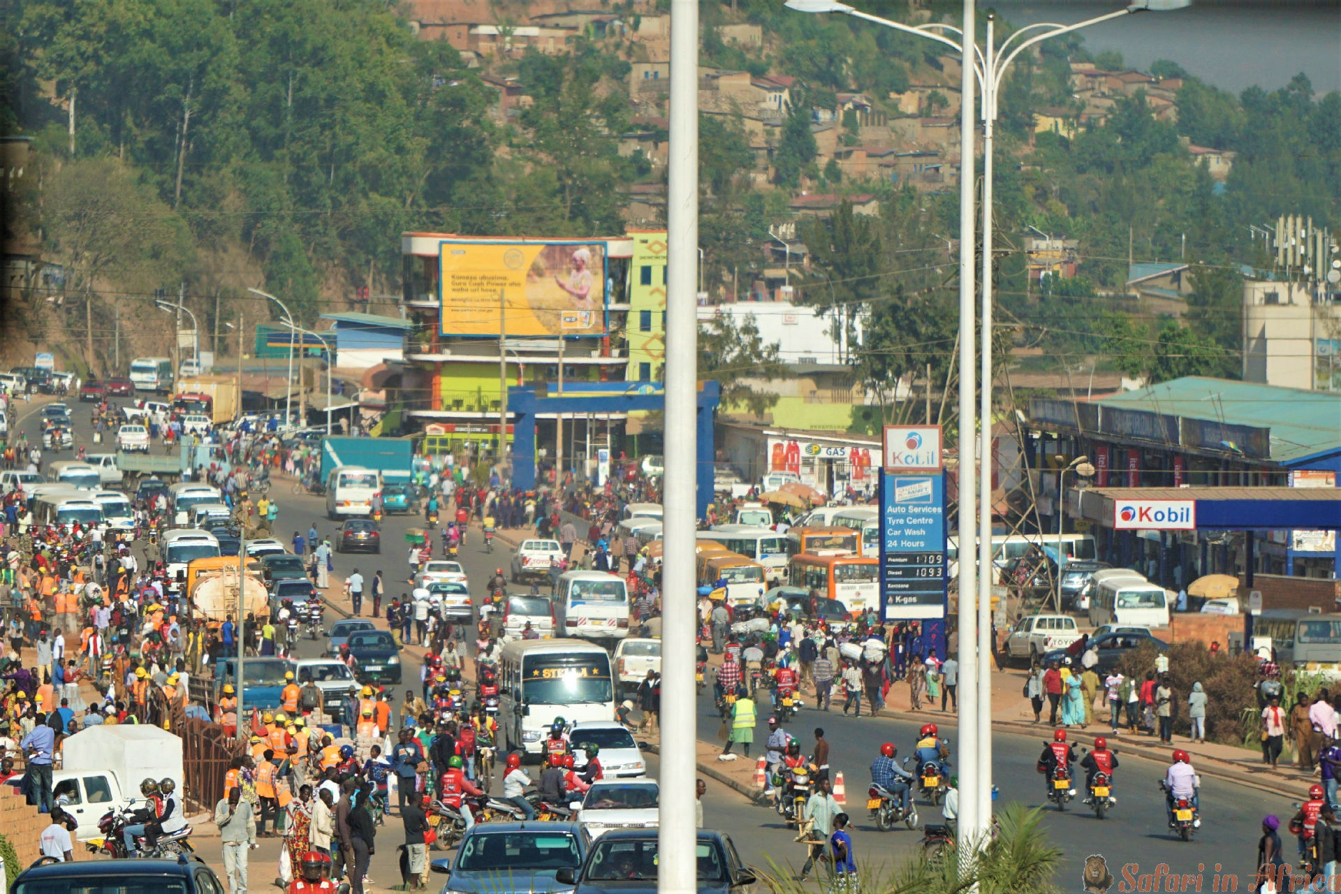 Bustling crowds amid shops in main intersection of downtown Kigali in Rwanda