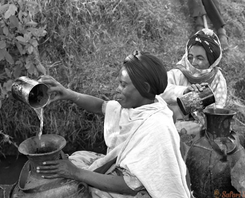 Ethiopian women fetch water from natural well. Oromia B&W