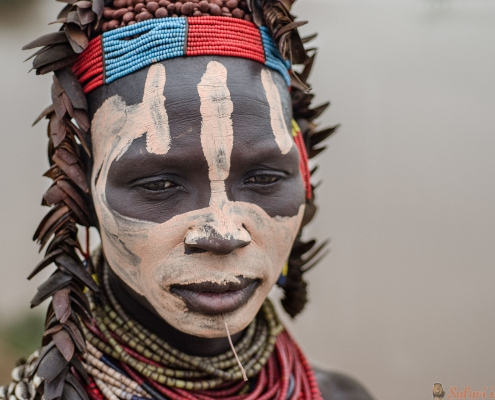 Karo woman wearing natural ornaments in Turmi, Ethiopia