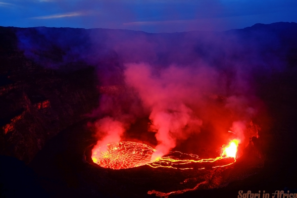 Lava and steam in crater of Nyiragongo volcano in Virunga Nation. Lake, action.