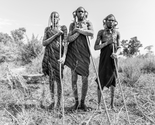 Mursi men at Mago National Park with amazing decorations and body painting. B&W