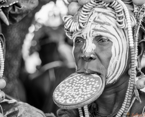 Mursi tribe with big lip Plate, in Mago National Park, Jinka, Ethiopia B&W