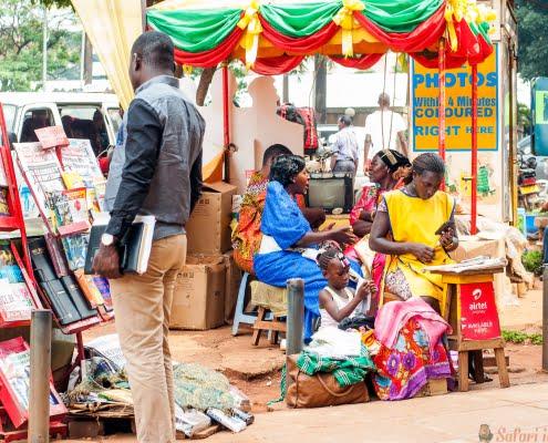 Newspaper and stationary stand and cell phone kiosk on sidewalk, Kampala Road, Kampala