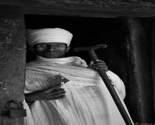 Priest on the doorway of Abuna Yemata Guh church. Ethiopian, icon B&W