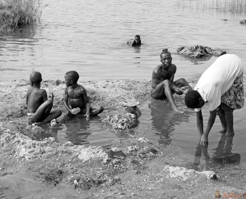 Rwnadan family are washing themself and cooking the food at the hot spring water on the lake Kivu, near Gisenyi