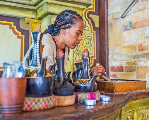 The young EthiopianTigrayan girl at work - she roasts coffee beans for the traditional coffee ceremony