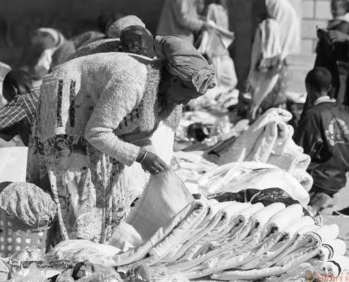 textile market stall in the dusty street of Hawzen, southern Tigray region, Ethiopia B&W