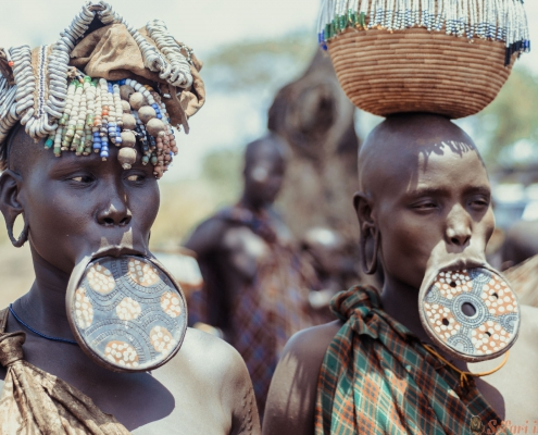 unidentified women from Mursi tribe with big lip Plate, in Mago National Park
